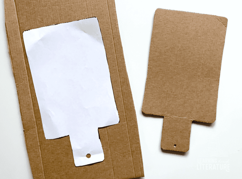Use the template to trace the hornbook shape on cardboard. Cut out.