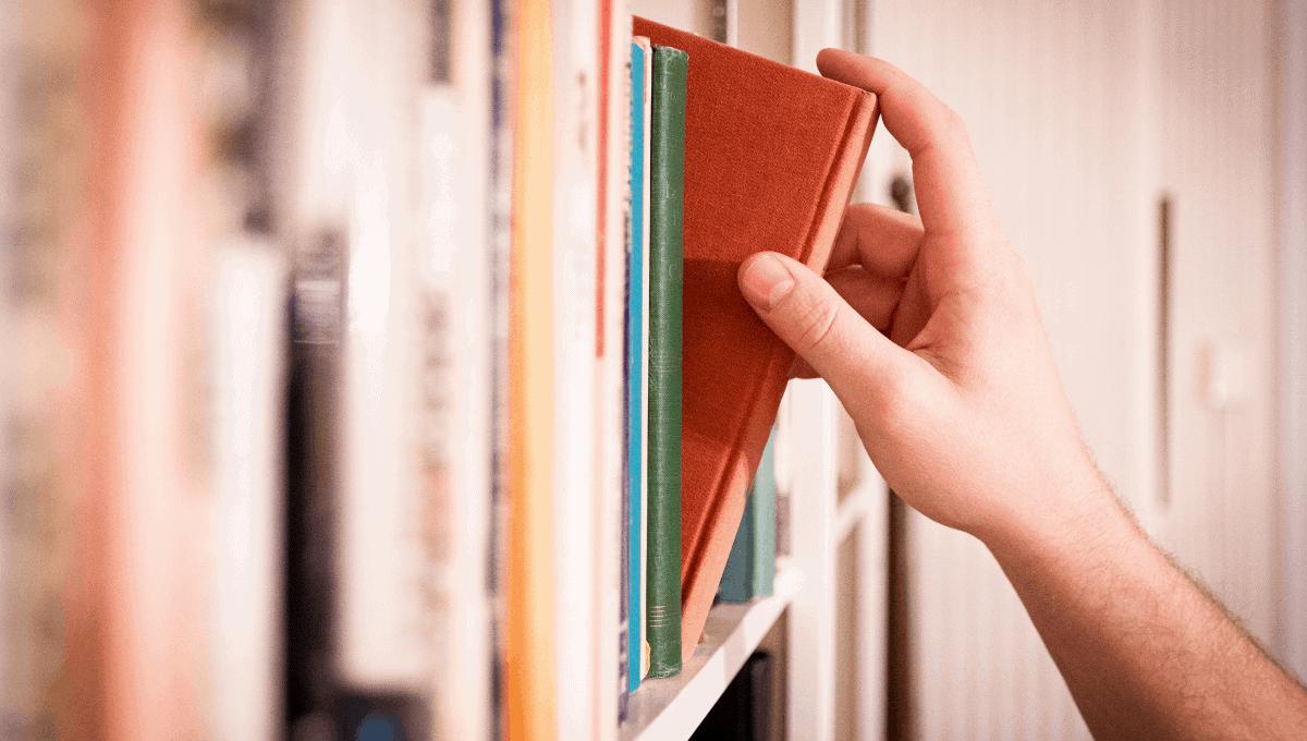 Choosing a book from shelf